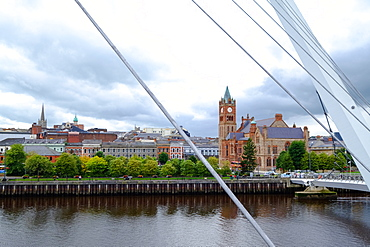The Peace Bridge and the Guildhall in Derry, County Londonderry, Ulster, Northern Ireland, United Kingdom, Europe