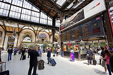 Passengers traversing through train station, by the arrival/departure board, Gare de Lyon train station, Paris, France, Europe