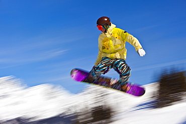 Snowboarder flying off a ramp, Whistler Mountain, Whistler Blackcomb Ski Resort, Whistler, British Columbia, Canada, North America