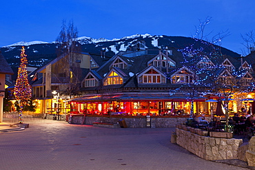 Village Square, Whistler VIllage at dusk, Whistler Blackcomb Ski Resort, Whistler, British Columbia, Canada, North America