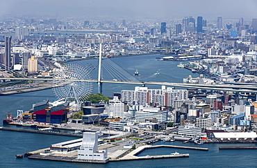 Central Osaka City behind the Tempozan Bridge which crosses over the Aji River at Osaka Bay, Osaka, Japan