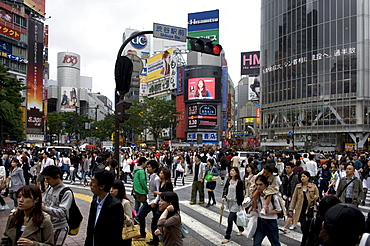 Shibuya crossing in front of the Shibuya train station is one of Tokyo's busiest city centers, Tokyo, Japan, Asia