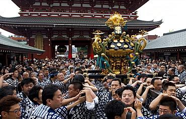 A mikoshi (portable shrine) being carried to Sensoji Temple during the Sanja Festival in Asakusa, Tokyo, Japan, Asia