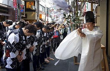 Shinto priest blessing a group of Sanja Festival participants in a religious ceremony in Asakusa, Tokyo, Japan, Asia
