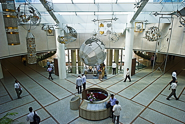 Traders cross the floor in the lobby of the World Trade Center, Colombo, Sri Lanka, Asia