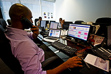 A trader at work on the 32nd floor of the World Trade Center in Colombo, Sri Lanka, Asia