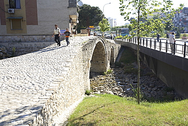 People walking over the Tanner's bridge, an Ottoman stone footbridge in Tirana, Albania, Europe