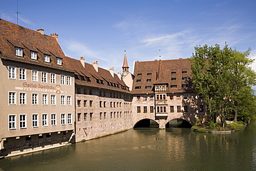 The Holy Ghost Hospital (Heilig-Geist-Spital), one of Europe's largest medieval hospitals, by the river Pegnitz in Nuremberg, Bavaria, Germany, Europe