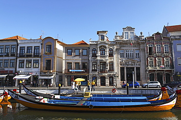 Moliceiro boats docked by Art Nouveau style buildings along the Central Canal, Aveiro, Beira Litoral, Portugal, Europe