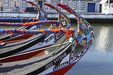 The prows of gondola-like Moliceiros, boats used to give tourists rides along the canals of Aveiro, Beira Litoral, Portugal, Europe