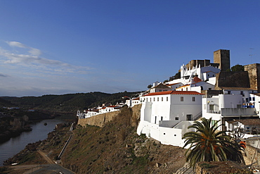 The 13th century castle and walled city, with a strong Islamic history, overlooking the Guadiana River, Mertola, Alentejo, Portugal, Europe