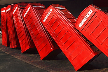 British red K2 telephone boxes, David Mach's Out of Order sculpture, at Kingston-upon-Thames, a suburb of London, England, United Kingdom, Europe