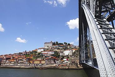 The Dom Luis I Bridge spans the River Douro to the Ribeira District UNESCO World Heritage Site, Porto, Douro, Portugal, Europe
