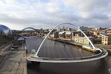 Millennium Bridge and Tyne Bridge span the River Tyne, from Gateshead to Newcastle, Tyne and Wear, England, United Kingdom, Europe