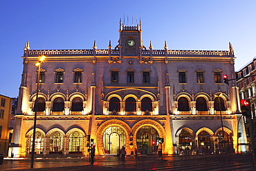 The Neo-Manueline facade of Rossio railway station, at night, in the Baixa district of Lisbon, Portugal, Europe