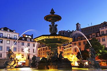Illuminated fountain at night, Rossio Square (Praca do Dom Pedro IV), in the Baixa district of Lisbon, Portugal, Europe