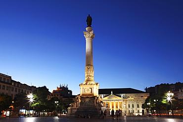 Statue of Portugal's King Dom Pedro IV, Dona Maria II national theatre at night, Rossio Square, Baixa district, Lisbon, Portugal, Europe