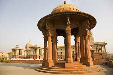 A chhattri stands in front of the Herbert Baker designed North Block Secretariat Building in New Delhi, India, Asia