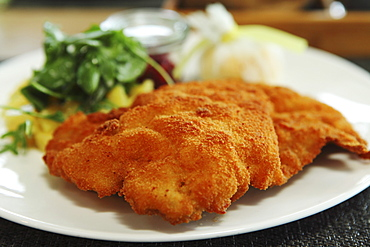 Wiener schnitzel, the popular breadcrumb coated cutlet of veal, a traditional Germanic dish, served in Munich, Bavaria, Germany, Europe