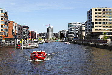 A boat on a canal in the recently developed HafenCity district of Hamburg, Germany, Europe
