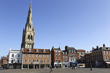 The spire of St. Mary Magdalene church rises over building on the Market Square in Newark-upon-Trent, Nottinghamshire, England, United Kingdom, Europe