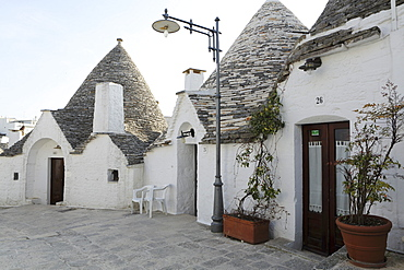 Cone-shaped trulli houses, in the Rione Monte district of Alberobello, UNESCO World Heritage Site, in Apulia, Italy, Europe