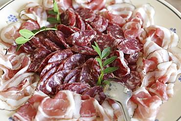 Regional Capocollo (capicola) ham surrounds salami produced in Martina Franca, Apulia, Italy, Europe