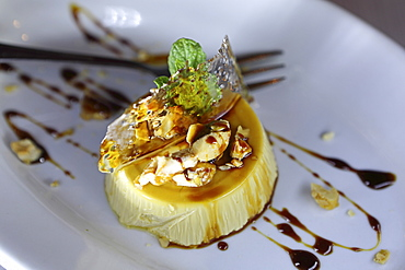 Pana cotta, a traditional Italian dessert, served with caramel and almonds, served near Castel del Monte in Apulia, Italy, Europe