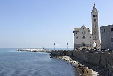 The Adriatic Sea, harbour wall and Cathedral of St. Nicholas the Pilgrim (San Nicola Pellegrino) in Trani, Apulia, Italy, Europe
