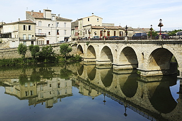 A Roman Bridge, built in the reign of the Emperor Tiberius, spans the River Vidourle at Sommieres, Gard, Languedoc-Roussillon, France, Europe