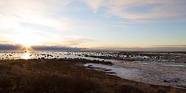 Sunrise over the semi-frozen Hudson Bay in northern Manitoba, Canada, North America