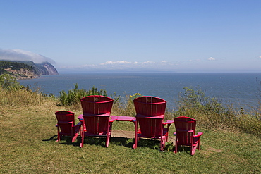 Parks Canada's red chairs at Fundy National Park, overlooking the Bay of Fundy, in New Brunswick, Canada, North America