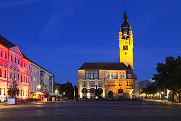 The illuminated city hall (Rathaus), with its Gothic-style clock tower, at night, in Dessau, Saxony-Anhalt, Germany, Europe