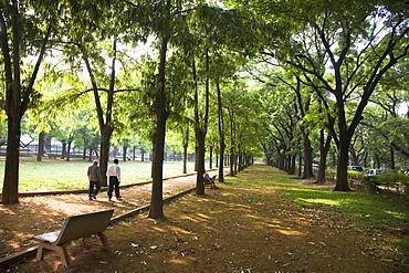 Men walk in Cubban Park in central Bangalore, Karnataka, India, Asia