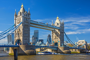 Tower Bridge over River Thames, City skyline including Cheesegrater and Gherkin skyscrapers beyond, London, England, United Kingdom, Europe