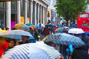 Shoppers in the rain, Oxford Street, London, England, United Kingdom, Europe