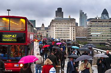 Commuters crossing London Bridge, London, England, United Kingdom, Europe