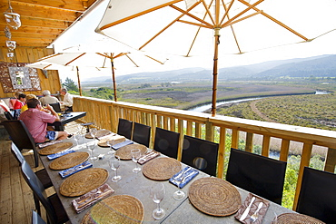 The restaurant and terrace of Emily Moon Lodge in Plettenberg Bay with the Bitou River in the background, Garden Route, Western Cape, South Africa, Africa