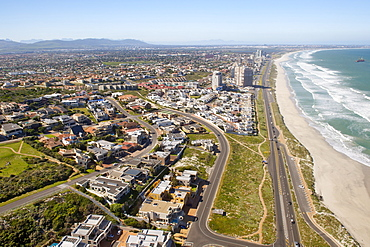 Aerial view down the beach and over the suburbs of West Beach, Blouberg and Table View in Cape Town, South Africa, Africa