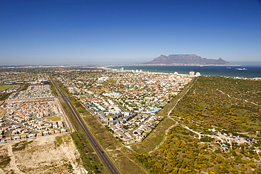 Aerial view down the beach and over the suburbs of West Beach, Blouberg, Sunningdale and Table View, Cape Town, South Africa, Africa