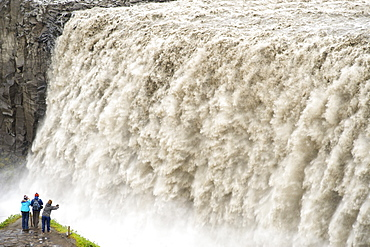 Tourists photographing Dettifoss waterfall near Myvatn in Vatnajokull National Park, northeast area, Iceland, Polar Regions