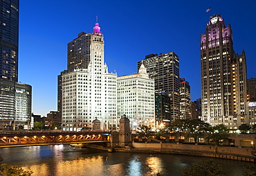 Night-time view of the Wrigley building in the centre and Tribune Tower on the right in downtown Chicago, Illinois, United States of America, North America