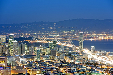 Dusk view of San Francisco and the Oakland Bay Bridge from the summit of Twin Peaks in California, United States of America, North America