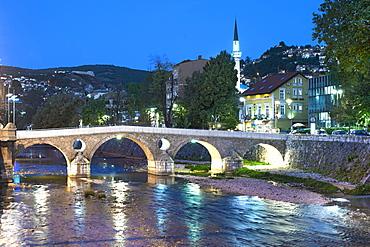 Dusk view of the Latin Bridge, a historic Ottoman bridge over the Miljacka River in Sarajevo, capital of Bosnia and Herzegovina, Europe
