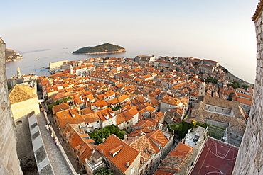 View from the Minceta Tower over the rooftops of the old town in the city of Dubrovnik, UNESCO World Heritage Site, with Lokrum Island beyond, Adriatic Coast, Croatia, Europe