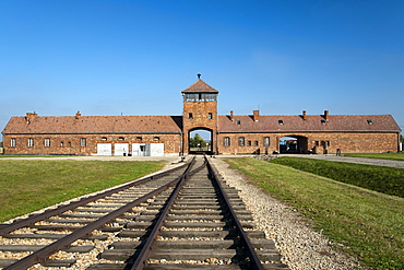 Entrance building and railway line of the former Auschwitz II-Birkenau concentration camp, UNESCO World Heritage Site, southern Poland, Europe