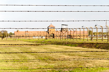 Barbed-wire fencing and buildings at the museum of the former Auschwitz II-Birkenau concentration camp, UNESCO World Heritage Site, Poland, Europe
