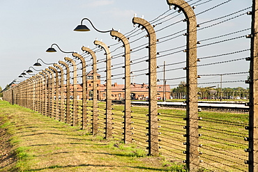 Electrified barbed-wire fencing and buildings at the museum of the former Auschwitz I-Birkenau concentration camp, UNESCO World Heritage Site, Poland, Europe