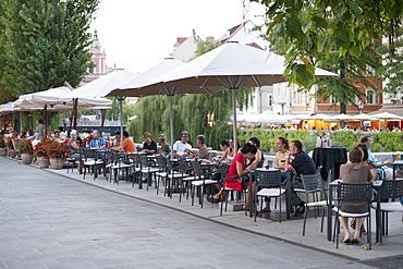 Sidewalk cafes on the banks of the Ljubljanica River in the old town in Ljubljana, Slovenia, Europe