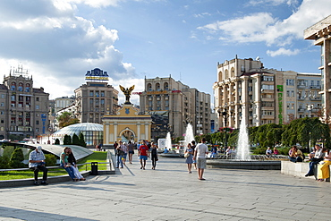 Pecerskyj gate and pedestrians in Independence Square (Maidan Nezalezhnosti) in Kiev, the capital of Ukraine, Europe